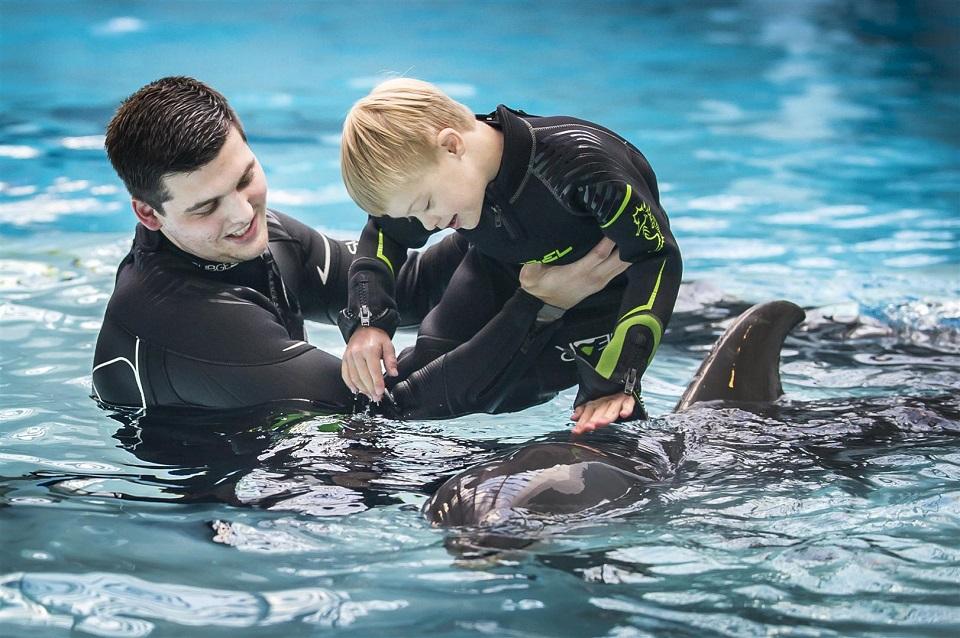 Baigiamasis paramos delfinų terapijai renginys